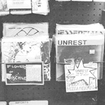 FLOWERS OF DISCIPLINE, UNREST, 7-inch singles on sale at Olsson's Books and Records, Georgetown, Washington, D.C.