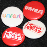 UNREST and Tee-Beat 26th Anniversary badges